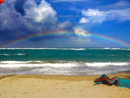 Rainbow Over KiteSurf Dominican Republic Beach Sunshine With Kite Laying On The Beach